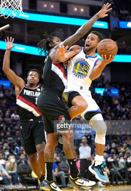 Stephen Curry of the Golden State Warriors looks to shoot over Ben McLemore of the Portland Trail Blazers during the second half of their game at...