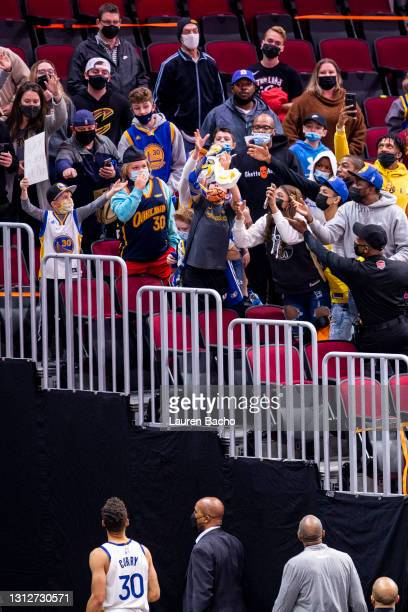 Stephen Curry of the Golden State Warriors looks up after throwing his towel to fans after the game against the Cleveland Cavaliers at Rocket...