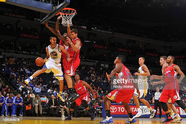 Stephen Curry of the Golden State Warriors makes a pass against the Los Angeles Clippers on October 8, 2010 at a preseason game at Oracle Arena in...