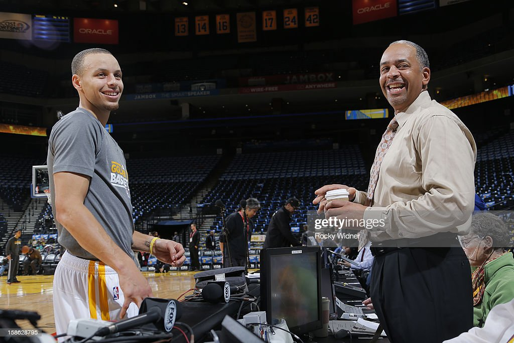 Stephen Curry #30 of the Golden State Warriors meets up with his father Dell Curry before the game against the Charlotte Bobcats on December 21, 2012 at Oracle Arena in Oakland, California.