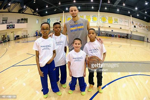 Stephen Curry of the Golden State Warriors met with four boys from the Make a Wish Foundation during the teams practice on January 9 2015 in Oakland...