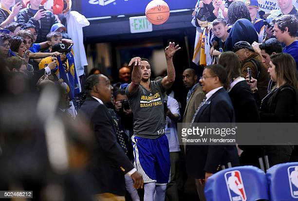 Stephen Curry of the Golden State Warriors on his way to the locker room after warming up shoots from the tunnel prior to playing the Cleveland...