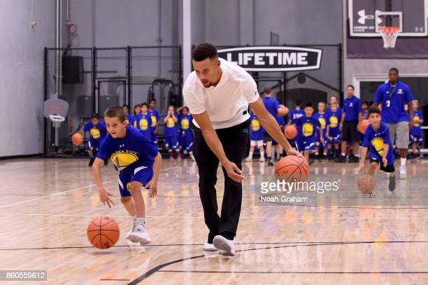 Stephen Curry of the Golden State Warriors participates in a Jr NBA clinic and Parent Forum focused on positive coaching at the Ultimate Fieldhouse...