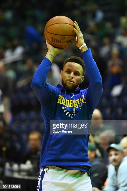Stephen Curry of the Golden State Warriors participates in warmups prior to a game prior to a game against the Milwaukee Bucks at the Bradley Center...
