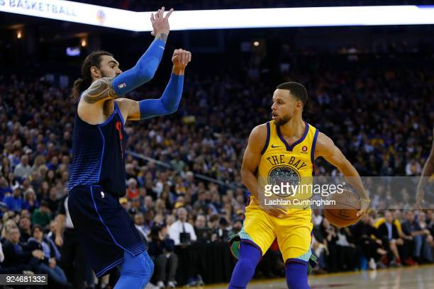 Stephen Curry of the Golden State Warriors pass the ball behind his back against Steven Adams of the Oklahoma City Thunder at ORACLE Arena on...
