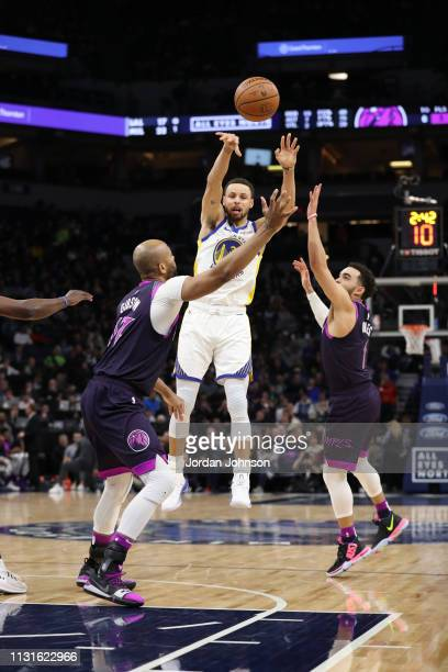 Stephen Curry of the Golden State Warriors passes the ball against the Minnesota Timberwolves on March 19 2019 at Target Center in Minneapolis...