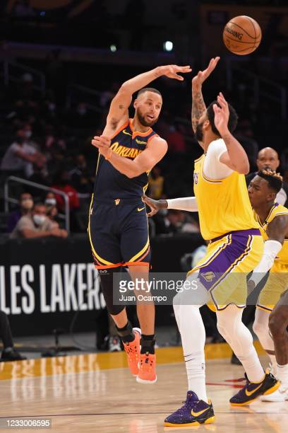 Stephen Curry of the Golden State Warriors passes the ball against the Los Angeles Lakers during the 2021 NBA Play-In Tournament on May 19, 2021 at...