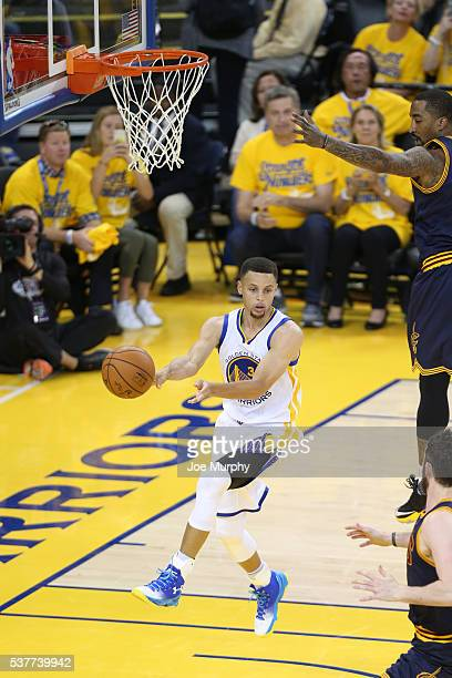 Stephen Curry of the Golden State Warriors passes the ball against the Cleveland Cavaliers in Game One of the 2016 NBA Finals on June 2, 2016 at...