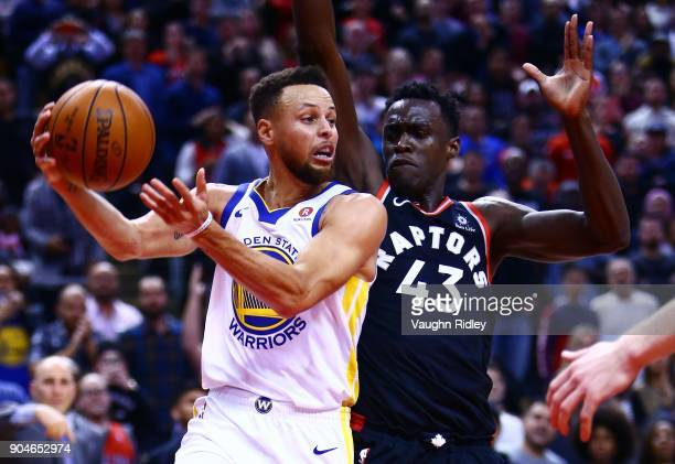 Stephen Curry of the Golden State Warriors passes the ball as Pascal Siakam of the Toronto Raptors defends during the second half of an NBA game at...