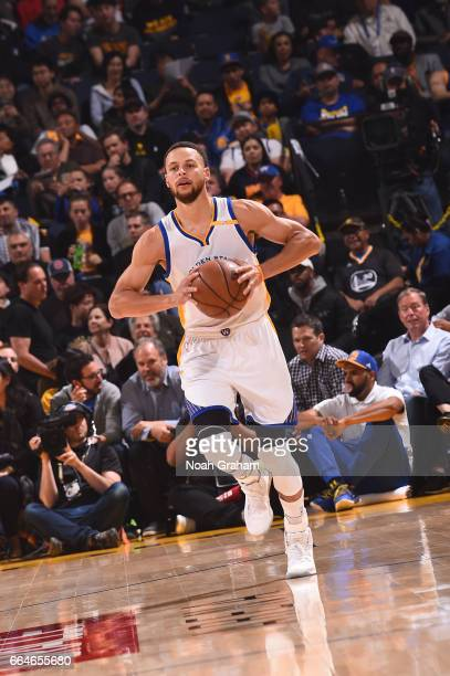 Stephen Curry of the Golden State Warriors passes the ball during a game against the Minnesota Timberwolves on April 4 2017 at ORACLE Arena in...