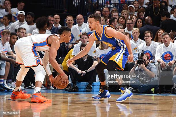 Stephen Curry of the Golden State Warriors plays defense against Russell Westbrook of the Oklahoma City Thunder in Game Four of the Western...