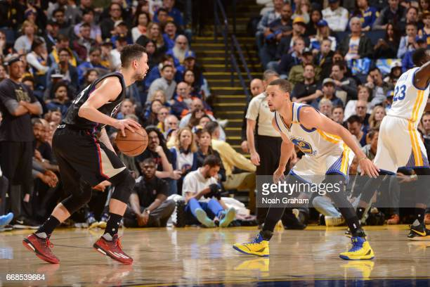 Stephen Curry of the Golden State Warriors plays defense against Austin Rivers of the Los Angeles Clippers on February 23 2017 at ORACLE Arena in...