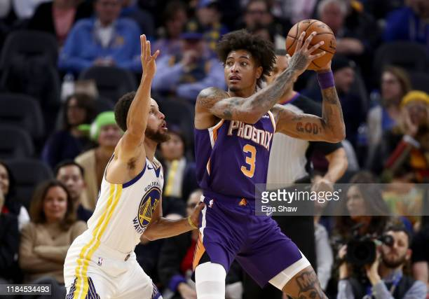 Stephen Curry of the Golden State Warriors plays defense on Kelly Oubre Jr. #3 of the Phoenix Suns at Chase Center on October 30, 2019 in San...