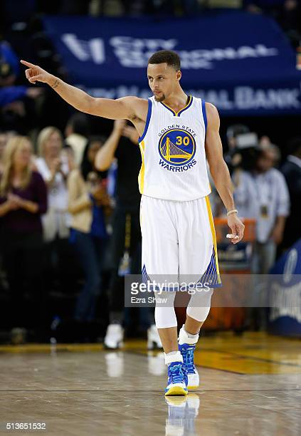 Stephen Curry of the Golden State Warriors points to the crowd at the end of their game against the Oklahoma City Thunder at ORACLE Arena on March 3...