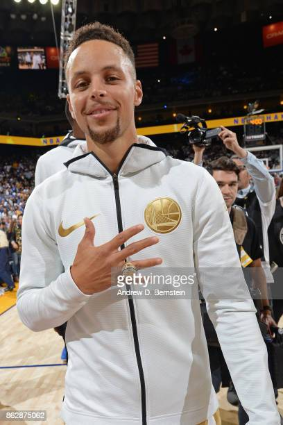 Stephen Curry of the Golden State Warriors poses for a photo with his championship ring before the game against the Houston Rockets on October 17...