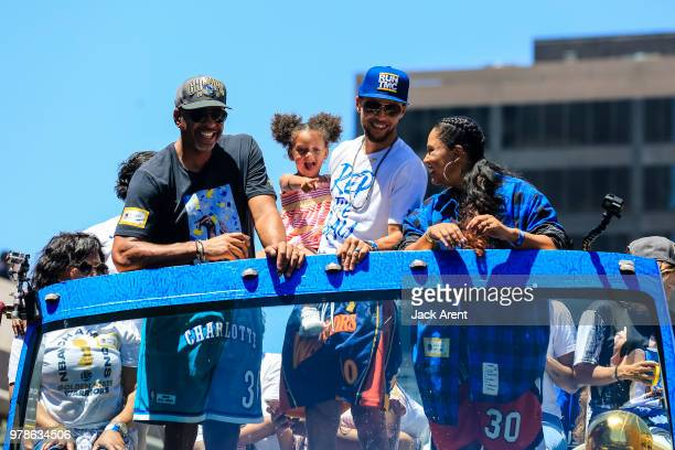 Stephen Curry of the Golden State Warriors poses for a photo with his family Dell Curry Ayesha Curry and Ryan Curry from his bus during the Victory...