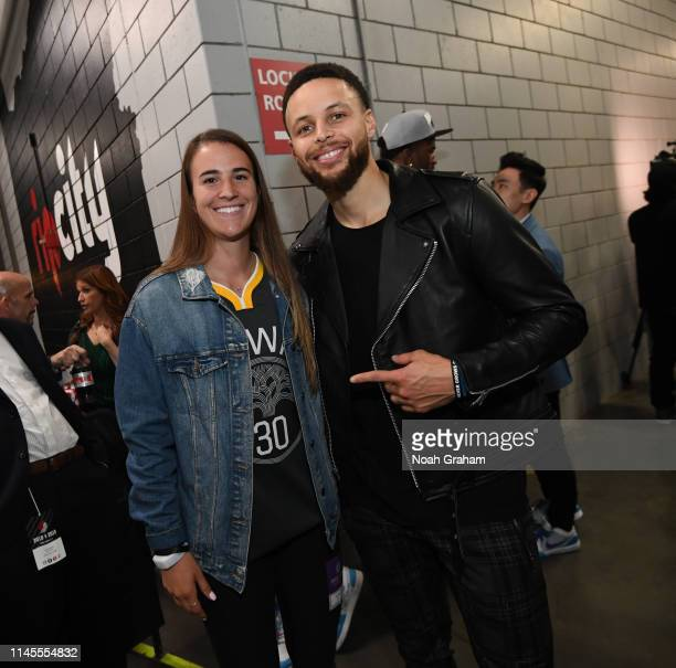 Stephen Curry of the Golden State Warriors poses for a photo with Oregon Ducks Basketball player, Sabrina Ionescu, after advancing to the NBA Finals...