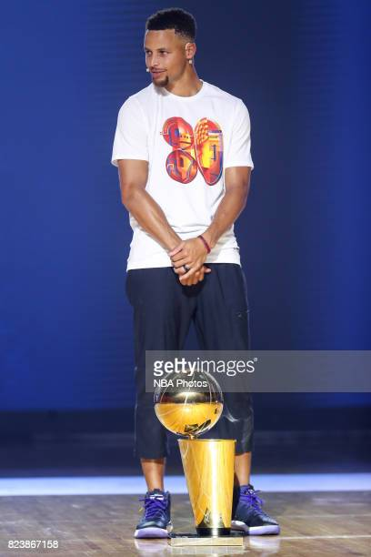 Stephen Curry of the Golden State Warriors poses for a photo with the Larry O'Brien Trophy at a Jr NBA Clinic to celebrate 30 Elites Day at the...