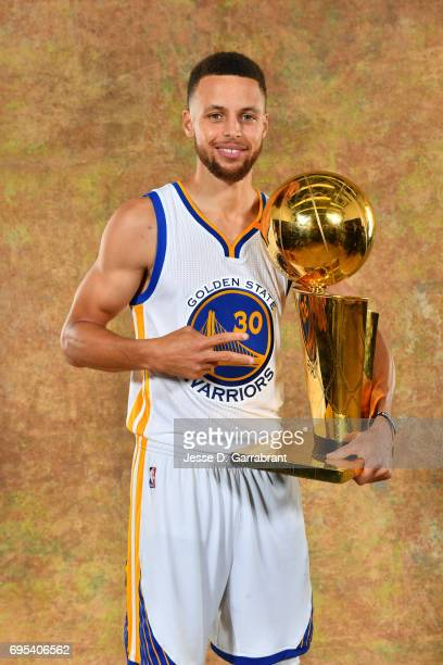 Stephen Curry of the Golden State Warriors poses for a portrait with the Larry O'Brien Trophy after defeating the Cleveland Cavaliers in Game Five of...