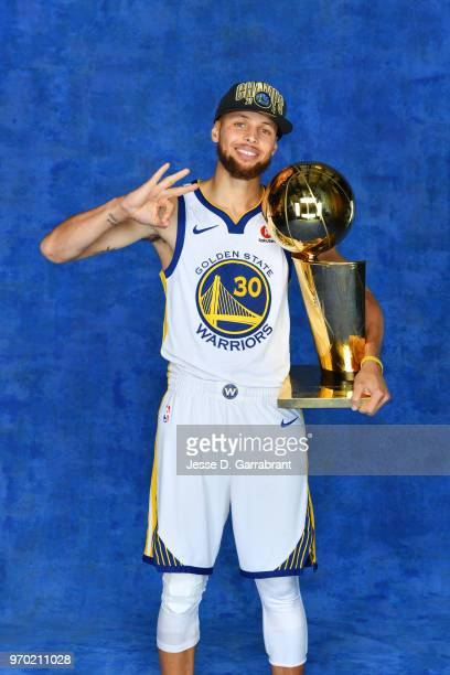 Stephen Curry of the Golden State Warriors poses for a portrait with the Larry O'Brien Championship trophy after defeating the Cleveland Cavaliers in...