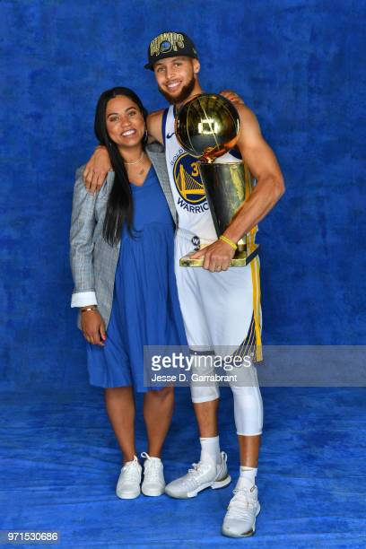 Stephen Curry of the Golden State Warriors poses for a portrait with his wife Ayesha Curry and Larry O'Brien Trophy after winning Game Four of the...