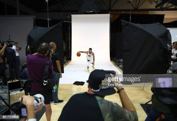 Stephen Curry of the Golden State Warriors poses for the Warriors' team photographer Noah Graham during the Golden State Warriors media day at...