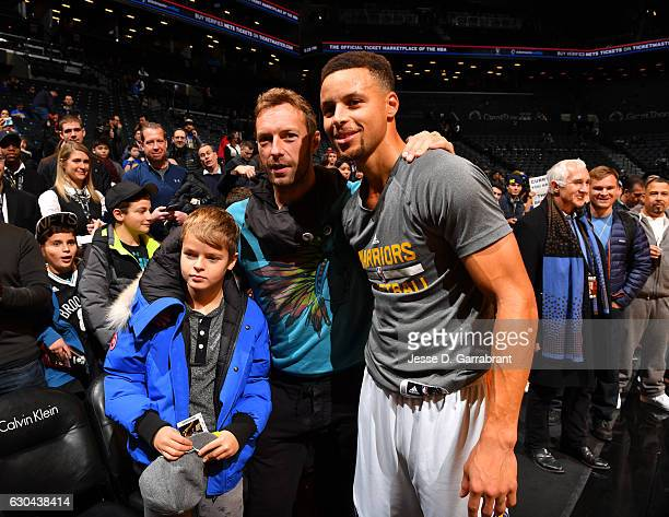 Stephen Curry of the Golden State Warriors poses with Chris Martin of Cold Play prior to the game against the Brooklyn Nets on December 222016 at...