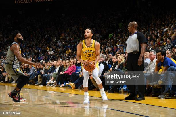 Stephen Curry of the Golden State Warriors prepares to shoots the ball against the Indiana Pacers on March 21 2019 at ORACLE Arena in Oakland...
