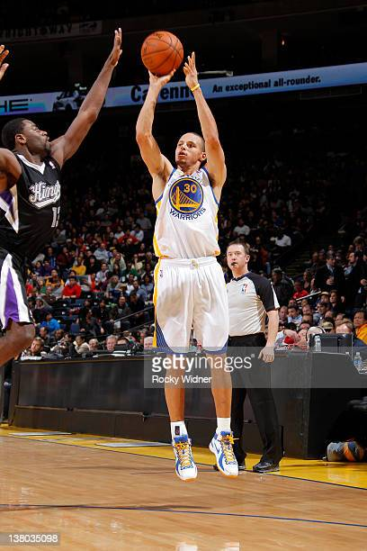 Stephen Curry of the Golden State Warriors pulls up for a jump shot over Tyreke Evans of the Sacramento Kings on January 31 2012 at Oracle Arena in...