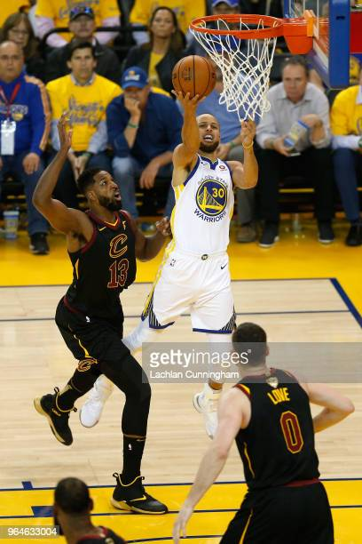 Stephen Curry of the Golden State Warriors puts up a layup over Tristan Thompson of the Cleveland Cavaliers in Game 1 of the 2018 NBA Finals at...