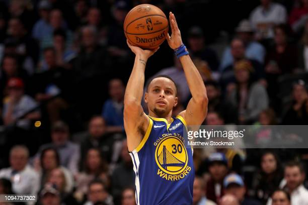 Stephen Curry of the Golden State Warriors puts up a shot against the Denver Nuggets in the first quarter at the Pepsi Center on January 15 2019 in...