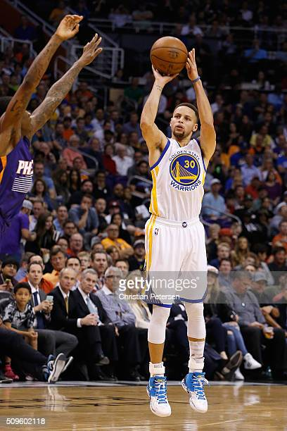 Stephen Curry of the Golden State Warriors puts up a shot during the NBA game against the Phoenix Suns at Talking Stick Resort Arena on February 10...