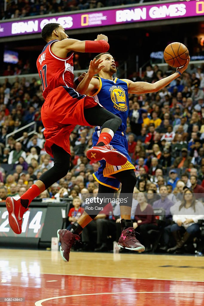Stephen Curry #30 of the Golden State Warriors puts up a shot in front of Garrett Temple #17 of the Washington Wizards in the first half at Verizon Center on February 3, 2016 in Washington, DC.