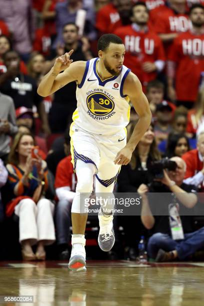 Stephen Curry of the Golden State Warriors reacts after a basket in the first half against the Houston Rockets in Game One of the Western Conference...