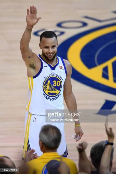 Stephen Curry of the Golden State Warriors reacts after a basket against the Cleveland Cavaliers during the first half in Game 1 of the 2018 NBA...