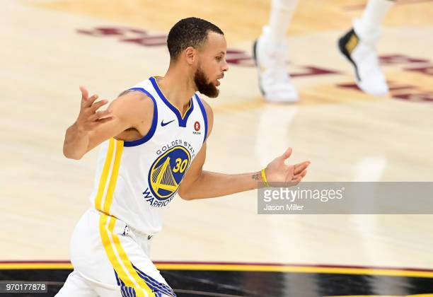 Stephen Curry of the Golden State Warriors reacts after a play in the first half against the Cleveland Cavaliers during Game Four of the 2018 NBA...
