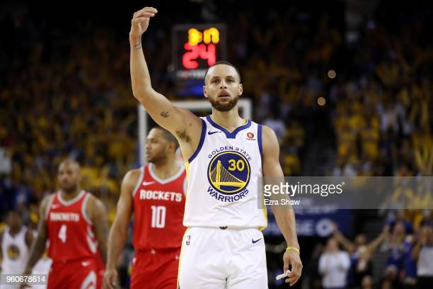 Stephen Curry of the Golden State Warriors reacts after a play against the Houston Rockets during Game Three of the Western Conference Finals of the...