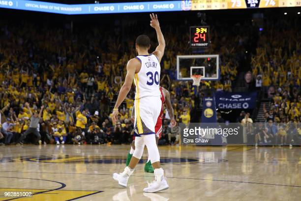Stephen Curry of the Golden State Warriors reacts after a play against the Houston Rockets during Game Six of the Western Conference Finals in the...