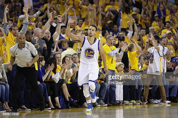 Stephen Curry of the Golden State Warriors reacts after a threepoint shot in Game Seven of the Western Conference Finals against the Oklahoma City...
