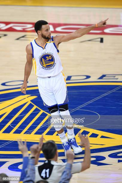 Stephen Curry of the Golden State Warriors reacts after a threepoint basket against the San Antonio Spurs during Game Two of the NBA Western...