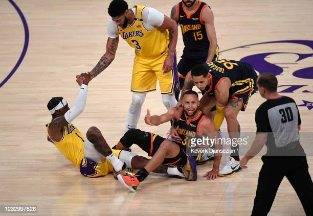 Stephen Curry of the Golden State Warriors reacts after an offensive foul against Kentavious Caldwell-Pope of the Los Angeles Lakers during the...