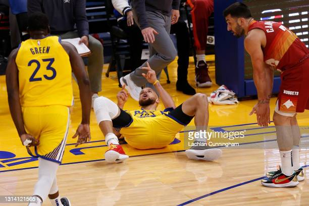 Stephen Curry of the Golden State Warriors reacts after being fouled as he made a basket in the fourth quarter against the Denver Nuggets at Chase...