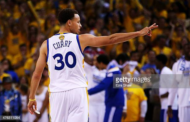 Stephen Curry of the Golden State Warriors reacts after being fouled in overtime against the Cleveland Cavaliers during Game Two of the 2015 NBA...