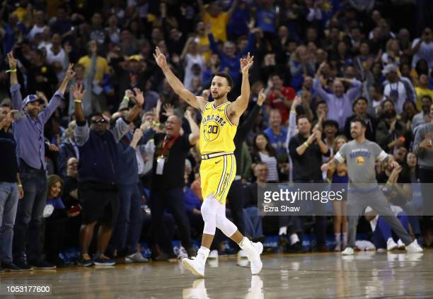 Stephen Curry of the Golden State Warriors reacts after he made a threepoint basket and was fouled by the Washington Wizards at ORACLE Arena on...