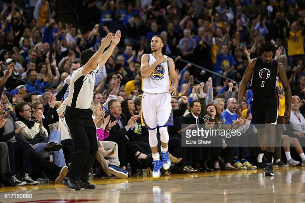 Stephen Curry of the Golden State Warriors reacts after he made a threepoint basket over DeAndre Jordan of the Los Angeles Clippers at ORACLE Arena...