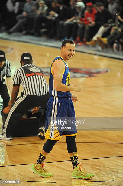 Stephen Curry of the Golden State Warriors reacts after his final round score of 27 in the Foot Locker Three Point Contest on State Farm AllStar...
