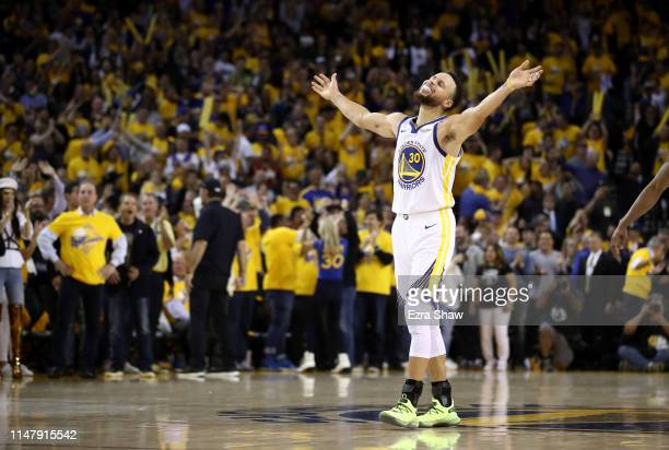 Stephen Curry of the Golden State Warriors reacts after Klay Thompson made the clinching basket with four seconds left of their game against the...