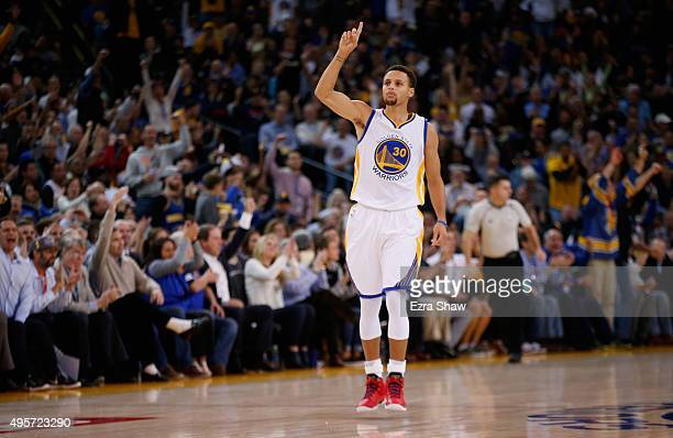 Stephen Curry of the Golden State Warriors reacts after making a threepoint basket against the Los Angeles Clippers at ORACLE Arena on November 4...