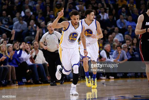 Stephen Curry of the Golden State Warriors reacts after making a threebasket against the Miami Heat at ORACLE Arena on January 11 2016 in Oakland...
