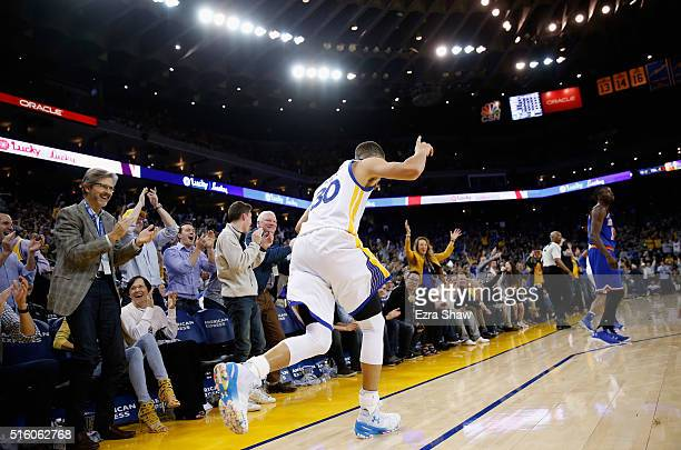 Stephen Curry of the Golden State Warriors reacts after making a threepoint basket against the New York Knicks at ORACLE Arena on March 16 2016 in...